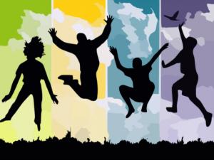 Personas saltando de felicidad
