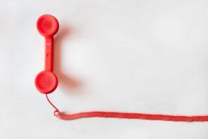 Telefono rojo símbolo de pedir ayuda